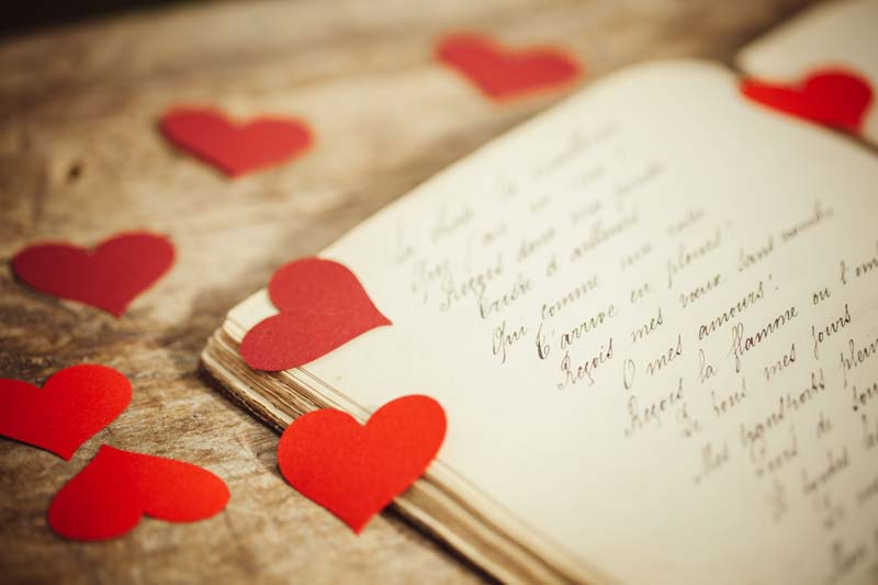 adobestock_77482079-book-with-hearts